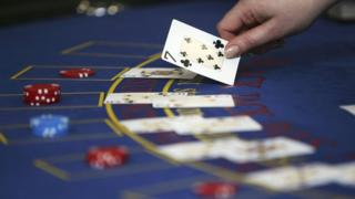 stock image of croupier dealing cards at a Black Jack table