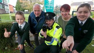 PC Jacky McDowell (centre) with pupils and staff from St Aloysius Primary School