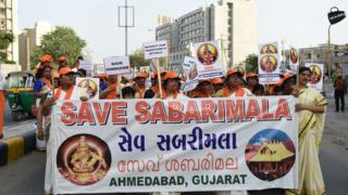 Indian Ayaappa devotees participate in a peaceful protest rally against the Supreme Court decision to allow women of all ages to enter inside the Kerala's Sabarimala temple, in Naroda area of Ahmedabad on October 14, 2018