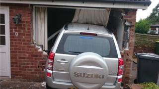 Car in house