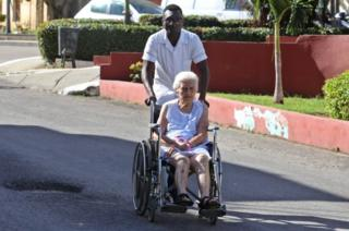 A health worker helps a lady in a wheelchair at the Calixto Garcia hospital in Havana, Cuba, on 14 November 2018