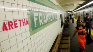 """""""Aretha"""" is spray painted next to a sign at the Franklin Avenue subway station, in memory of singer Aretha Franklin, in the Brooklyn borough of New York, U.S. August 16, 2018."""