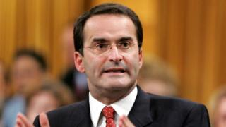 Former Canadian Transport Minister Jean Lapierre stands to speak in the House of Commons on Parliament Hill in Ottawa in this file photo taken November 16, 2005