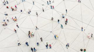An aerial photo of people joined by lines on the ground