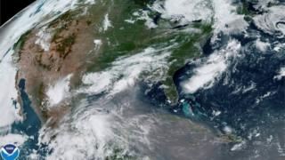 A plume of dust from the Sahara Desert approaches the United States from the Caribbean in an image from the National Oceanic and Atmospheric Administration (NOAA) GOES-East satellite June 24, 2020.