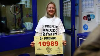 Food A worker of a lottery office in Madrid celebrates selling the number 10989 that got the second prize in the lottery draw in Madrid.