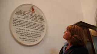 Jane Corbin with the plaque to her ancestor, Leo