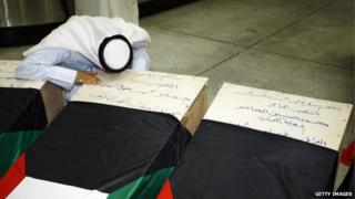 A Kuwaiti man mourns over the coffin of a relative, who lost his life during the attack on a mosque in Kuwait City that killed at least 27 people on Friday.