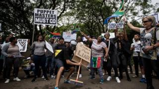 A protest outside the Gupta family compound in Johannesburg earlier this year