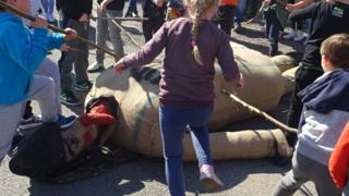 Children beating Judas effigy in Pruchnik, 19 Apr 19