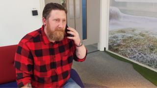 Scott Forsyth speaking on his phone at BBC Newcastle
