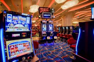 This picture taken on September 19, 2012 shows gambling machines in the Cotai new Sands casino in Macau.