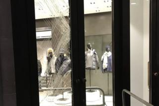 Smashed shop window at Canada Goose