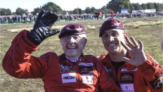 "Sandy Cortmann with parachute ""instructor"""
