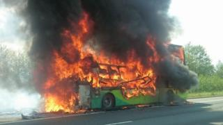 The coach in flames