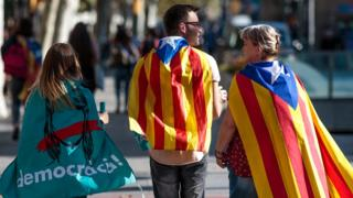 Protesters gather in the city center to demonstrate against the Spanish federal government;s move to suspend Catalonian autonomy