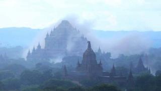 The ancient Dhammayangyi temple is seen shrouded in dust as a 6.8 magnitude earthquake hit Bagan on August 24, 2016