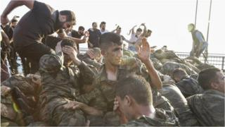 Images from Turkey appear to show captured soldiers being beaten up by civilians