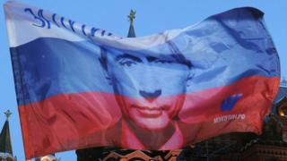 A Russian flag printed with President Putin's face