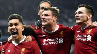 Liverpool's players celebrate scoring against Manchester City