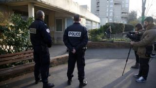 French police and journalists stand in front of the nursery school in Aubervilliers, near Paris. 14 Dec 2015