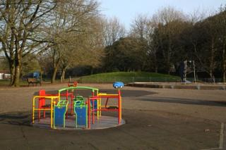 An empty children's play area on Llandaff Fields in Cardiff