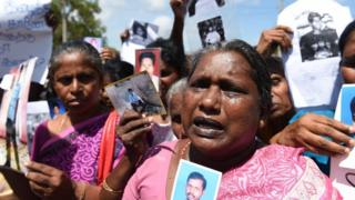 Sri Lankan mothers from the 'Missing Person's Parents' join others as they hold photographs during a protest outside the Jaffna Library in Jaffna,some 400 kilometres (250 miles) north of Colombo on September 2, 2016. UN Secretary-General Ban Ki-moon has toured Sri Lanka's former killing fields and met with war-battered minority Tamils after urging Colombo to reduce the army's presence to ease tensions following decades of ethnic bloodshed.The UN Secretary-General held talks with the main opposition politicians in the northern town of Jaffna, 400 kilometres (250 miles) north of Colombo on the final leg of the two day visit. / AFP / ISHARA S.KODIKARA (Photo credit should read ISHARA S.KODIKARA/AFP/Getty Images)