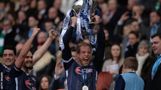 Andrew Davies lifting the Scottish League cup