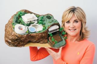 Anthea Turner holding a Tracy Island model in 2015