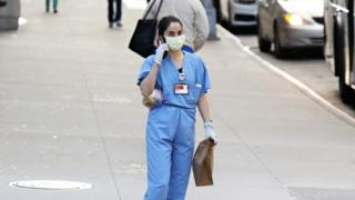 A medical worker wears a mask in New York