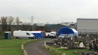 Forensic teams at Milltown cemetery