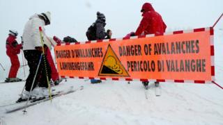 An avalanche warning banner in eastern France