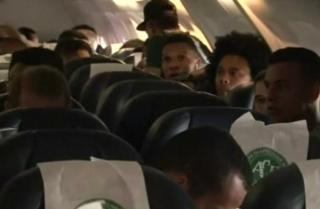 Some of the Chapecoense team in their seats before flying to Medellin