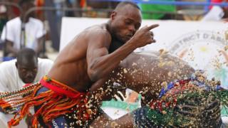 Debe Blaise of Burkina Faso (right) takes on Niger's Garba Mourtala in the men's wrestling 66kg quarter-final on Thursday 28 July.