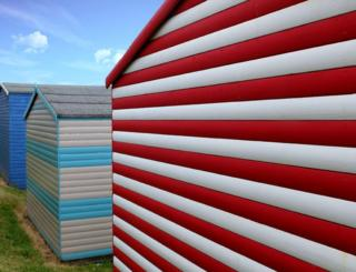 Red and blue coloured beach huts