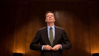 James Comey prepares to testify before a Senate committee.