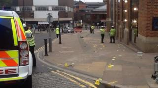 Police at the scene of the crash in the centre of Guildford
