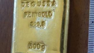 Marks on the gold bar might help identify where it came from