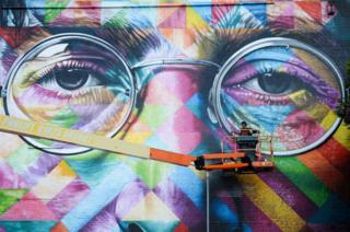 A graffiti artist work on a huge mural of John Lennon as he takes part in Upfest, a street art and graffiti festival in Bristol.