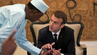 """Chad""""s president Idriss Deby Itno speaks with French President Emanuel Macron as they gather with Malian, Burkinabe, Nigerien and Mauritanian leaders for the G5 Sahel summit"""