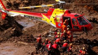 Rescuers seek victims at the scene of the accident - January 28