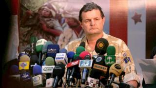 Maj Gen Graham Binns prepares to sign a memorandum of understanding at a press conference in Basra airport as the security control for the southern province of Basra was formally handed back to the Iraqis.