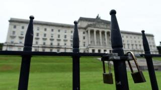 A padlocked gate in front of Stormont's parliament buildings