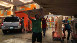 People buy materials at a hardware store in Puerto Rico