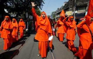 Hindu nuns shout slogans during a rally to mark the International Women's Day in Kolkata, India
