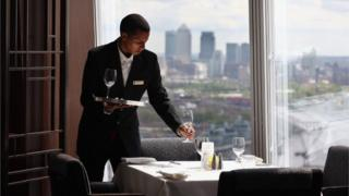 A waiter lays in the Shangri-La Hotel at the Shard
