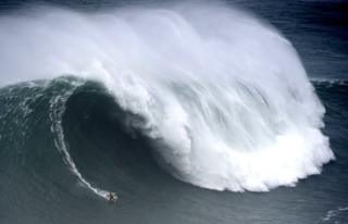 Spanish surfer Axier Muniain rides a wave