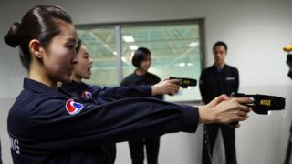Korean Air crew practice using electric stun guns