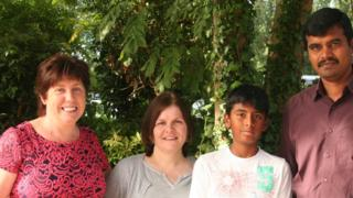 Gughan Ramakrishnan (third from the left), with his father (far right), Mairead Weir principal of St Joeseph's Primary School Mairead Weir (first left) and his year seven teacher Oonagh Dawson (second left)