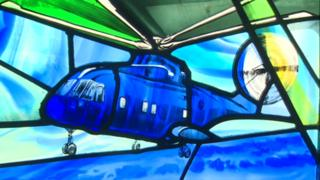 A Merlin helicopter depicted in a stained glass window.